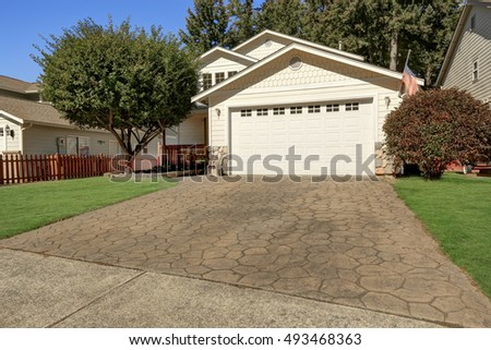 House exterior. Close up of garage door and driveway with stone tile. Northwest, USA