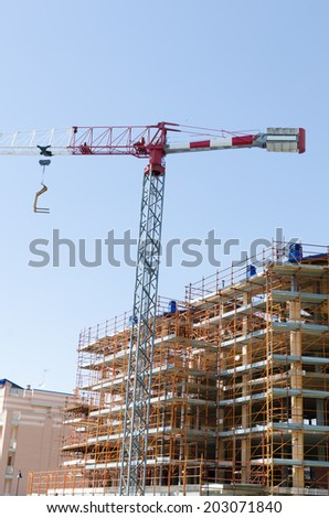 House exterior in construction and cranes