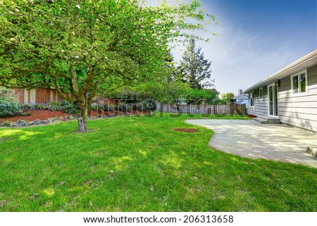 House exterior. View of backyard walkout deck and small garden - stock photo