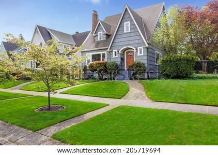 House exterior. View of landscape on front yard - stock photo