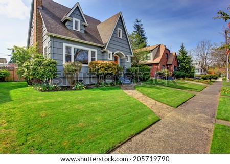 House exterior. View of landscape on front yard