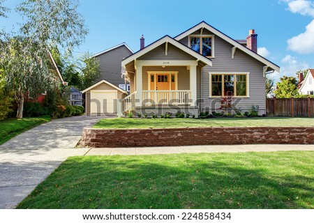 House exterior with front yard landscape. White entrance porch with railings and orange entrance door