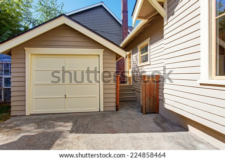 House exterior with garage and driveway. Clapboard siding trim - stock photo