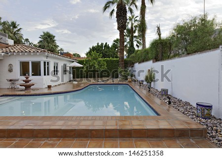 House Exterior with swimming pool - stock photo