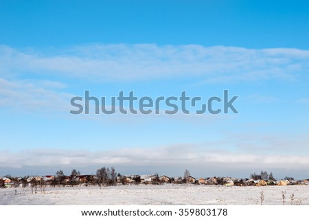 House field and sun in winter day in clear weather. - stock photo