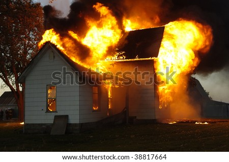 house fire engulfed - stock photo