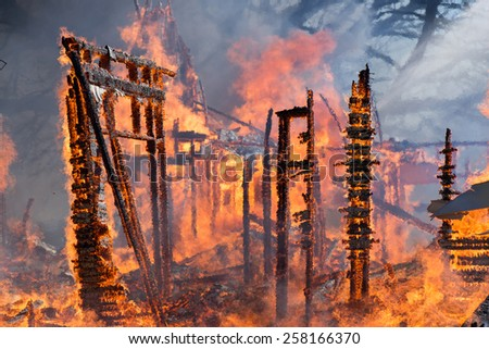 House fire in the final stages of destruction. - stock photo