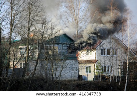 house fire in village - stock photo