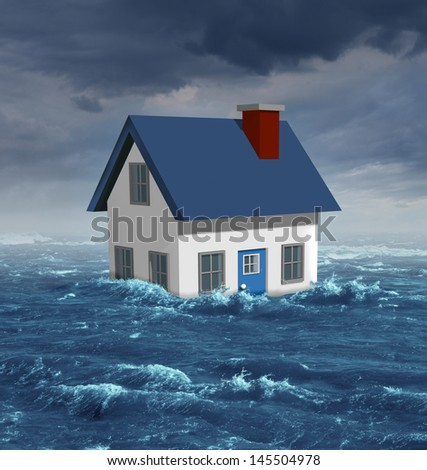 House flood insurance concept as a generic residential home damaged in a flooding disaster by severe weather or hurricane with environmental damage and economic hardships in the real estate industry. - stock photo
