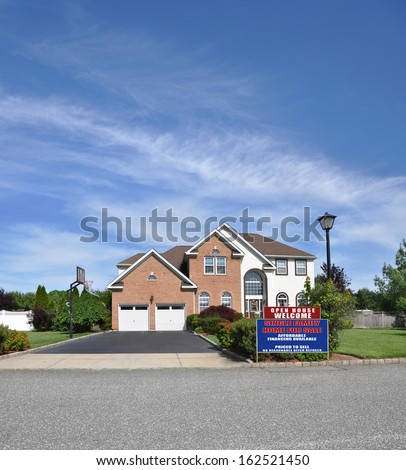 House For Sale Real Estate Sign No Closing Costs Affordable Suburban Brick McMansion Home Two Car Garage Lamppost Landscaped front yard Residential Neighborhood Blue Sky Clouds USA - stock photo