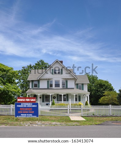 House For Sale Real Estate Sign Suburban Home with White Picket Fence Daytime USA Blue Sky Clouds - stock photo