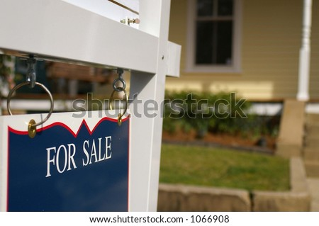 """House for sale with """"For Sale"""" sign - stock photo"""