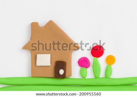 House  from children bright plasticine - Stock Image macro. - stock photo