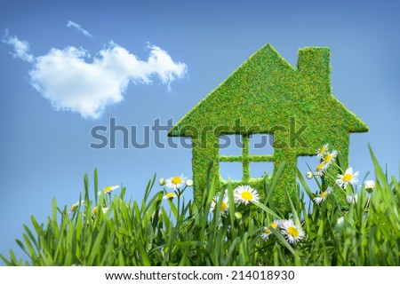 house from grass on blue sky - stock photo
