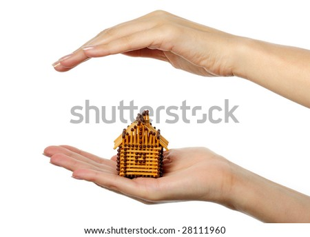 House from matches in human hand