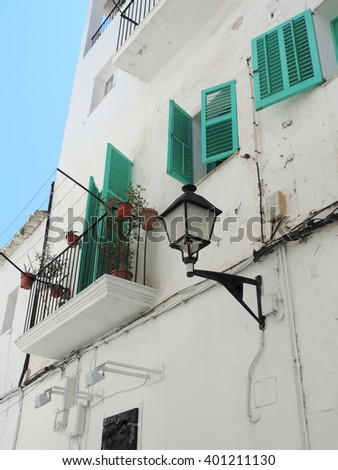 house front with turquoise shutters - stock photo