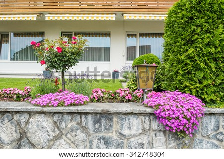 House front yard with flowers and trees in Vaduz, Lichtenstein