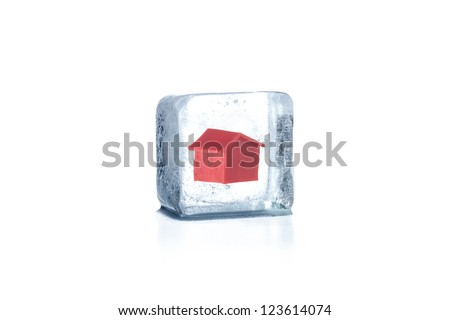 House frozen in ice cube - stock photo