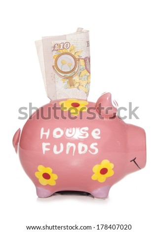 House funds savings piggy bank cutout - stock photo