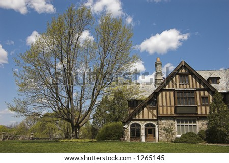House, grass, blue sky