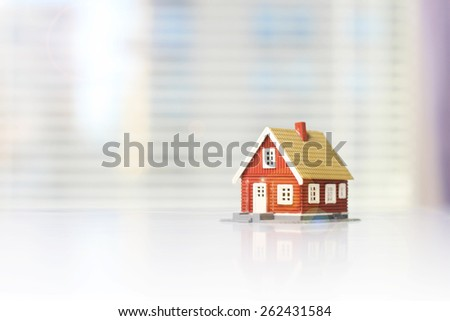 House house on a white table. Space for text. - stock photo
