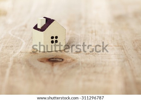 House Icon on wooden background