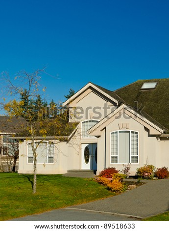 House in autumn with the dark blue sky as a background - stock photo