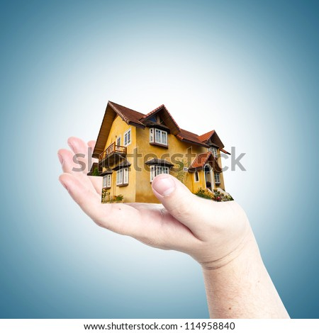 House in business man hand. Concept for business and real estate - stock photo