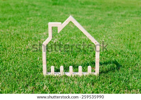 House in green field, house icon concept - stock photo