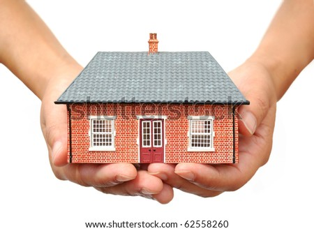 House in hands - stock photo