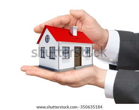 House in hands on isolated white background