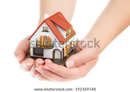 house in hands - real estate concept - stock photo