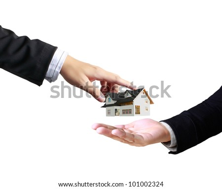 house in human a hands - stock photo