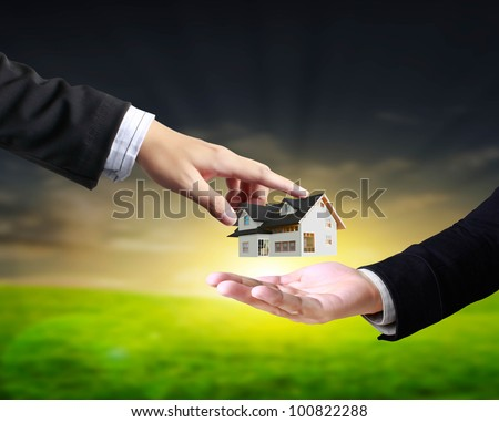 house in human hands, businessmen - stock photo