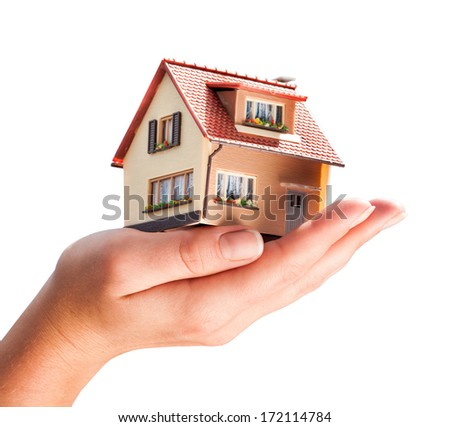 house in human hands isolated on a white background - stock photo