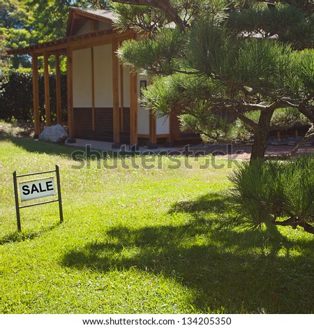 house in Japanese style on background of trees and card sale
