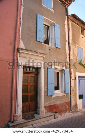 House in Provencal style, plastered facade and wooden shutters