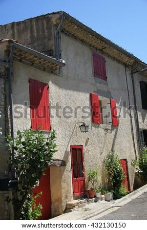 House in Provencal style, plastered facade and wooden shutters - stock photo