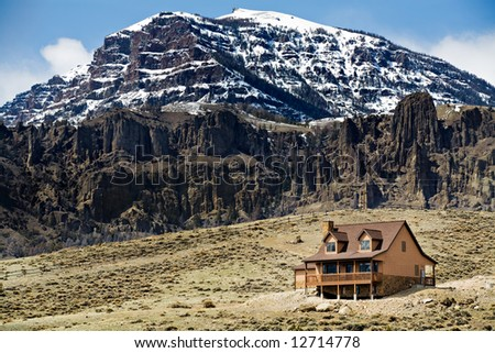 house in the mountains newly constructed - stock photo