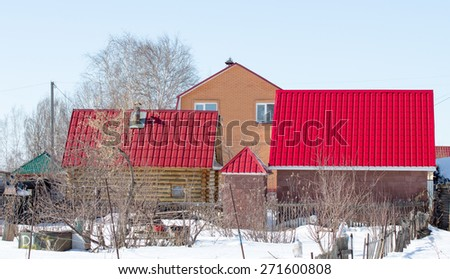 house in the village winter - stock photo