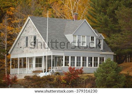 House in the woods - stock photo