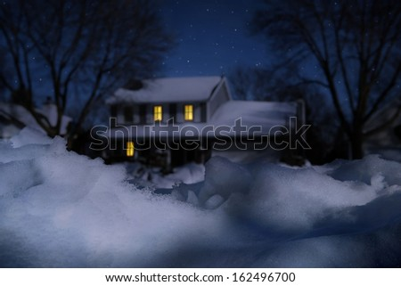 House in winter on a moonlit night - stock photo