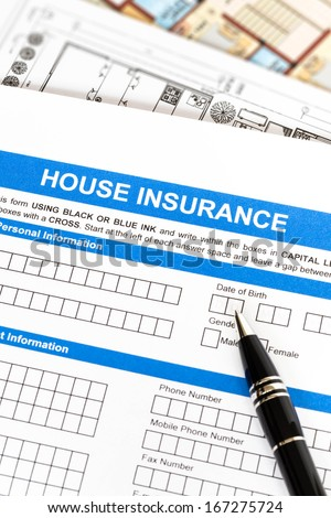 House insurance application with pen and construction plan