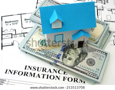 House insurance form with model house - stock photo