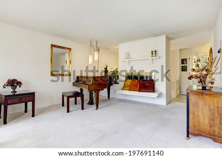 House interior. Room with fireplace, old piano and cabinet with drawer - stock photo
