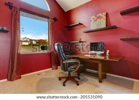 House interior. View of entrance hall with small office area with attached desk to wall