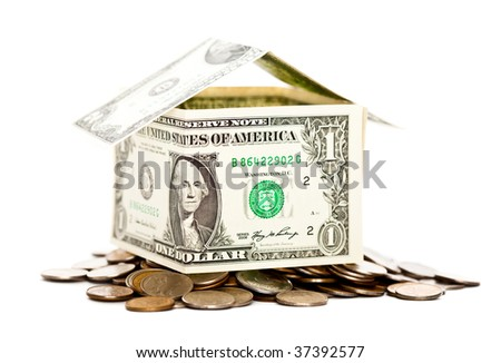 House is made from dollars. Isolated on white background