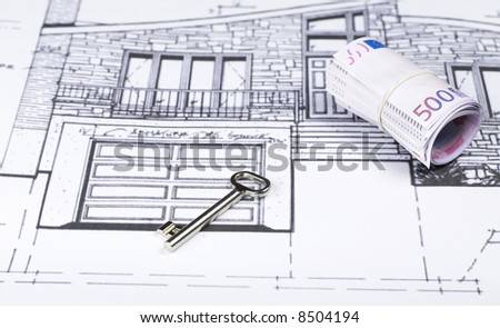 House key and money on Blueprint