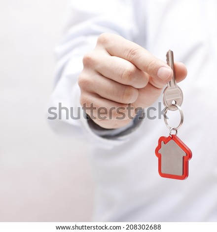 House key in hand - stock photo
