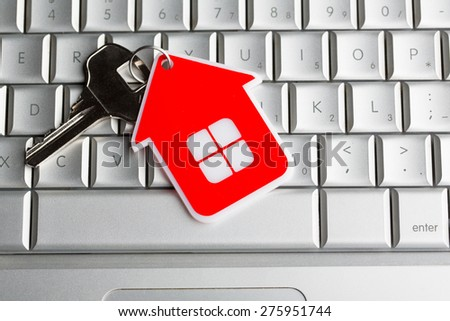 House key on laptop keyboard - stock photo